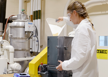 Mathilde Ricoux uses the aspirator to optimize milled grain fractions.