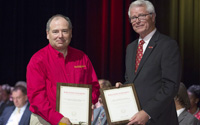 Kevin Keener, Center for Crops Utilization Research and BioCentury Research Farm director, (left) accepts the Award for Achievement in Economic Development in Iowa from Iowa State University Interim President Benjamin Allen at the 2017 Iowa State Faculty and Staff Awards Ceremony held Sept. 25.