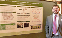 Image of Max Gangestad standing next to his algal wastewater treatment poster.