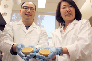 Tong Wang (right) leads an effort to find new uses for soybean oil at Iowa State University. Wang and postdoctoral research associate Tao Fei (left) believe soybean wax can be used as a coating for cardboard boxes as a more environmentally friendly alternative to paraffin wax. Image courtesy of Tong Wang.