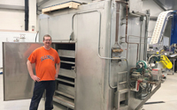 Phil Manning, IBRL pilot plant specialist, unloads the tray dryer into the IBRL facility. Photo courtesy of IBRL.